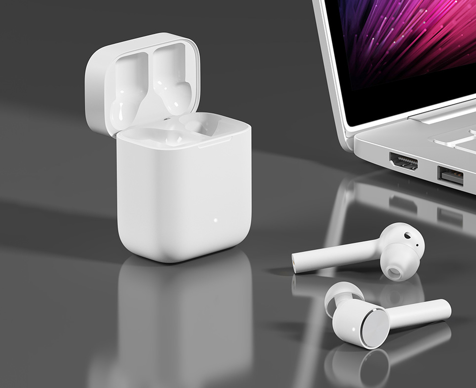 Наушники Xiaomi Air Mi True Wireless Earphones White возле ноута